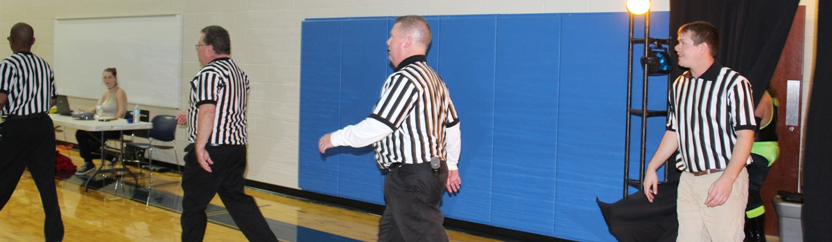 The Refs enter: Mr. Hobbs and Mr. Woods